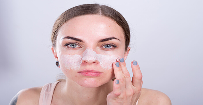 oily skin hydration, winter skincare, girl cleaning her face